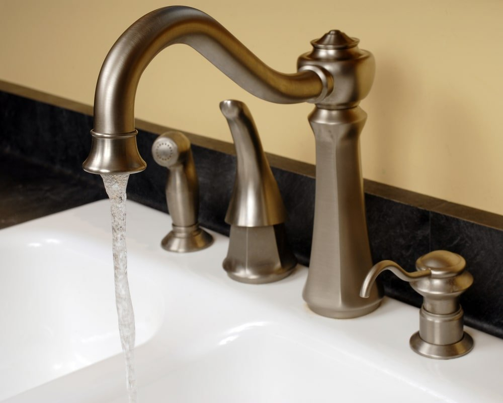 Bathroom sink faucet with brushed nickel finish.