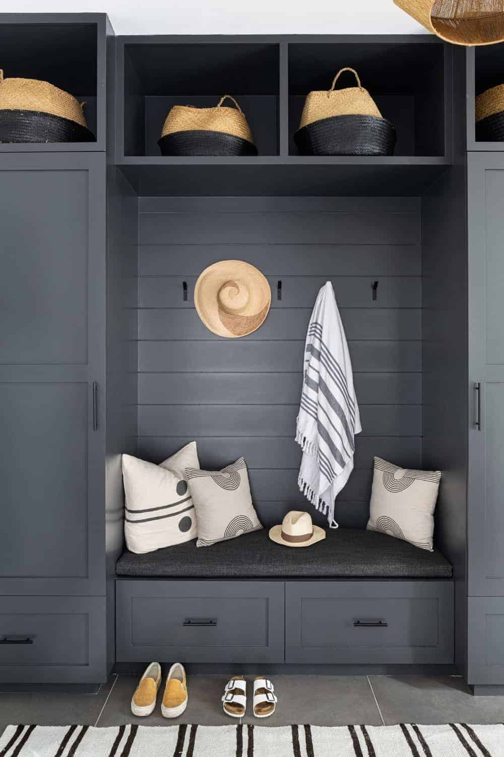 A close up look at the home's cabinet, shelving and bench seating finished in dark gray.