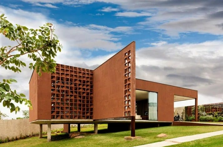 A contemporary house in Brazil featuring a brown exterior that looks very stylish.