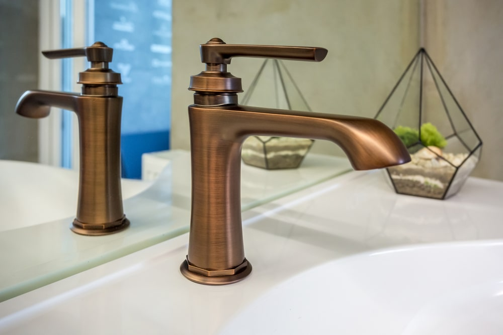 Bathroom sink faucet in copper finish.