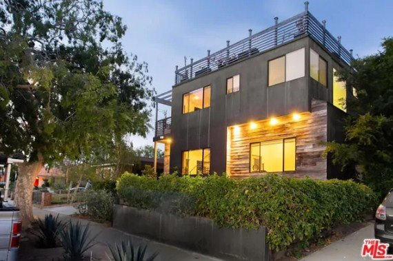 This custom contemporary home features a rooftop deck that offers amazing outdoor amenities.