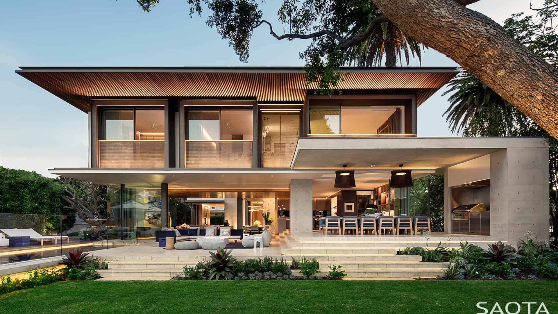 A large contemporary house designed by SAOTA. It features a peaceful garden area and a swimming pool area.