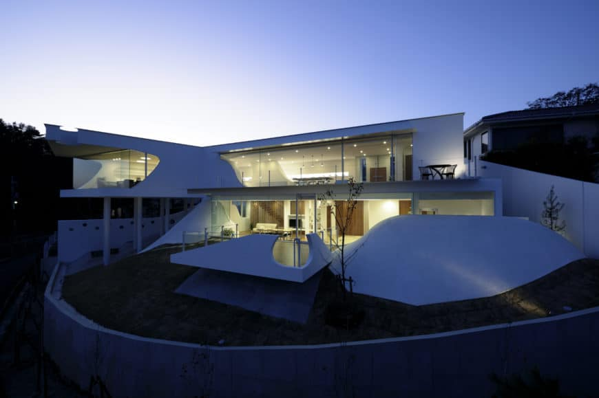 A contemporary house with a white exterior and a glamorous architectural design.