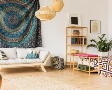 Stylish interior with tapestry used as wall art.