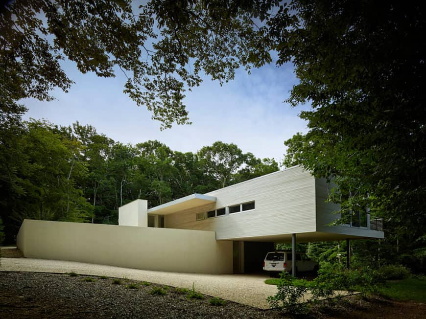 This contemporary house boasts its unique structure along with its gorgeous driveway.