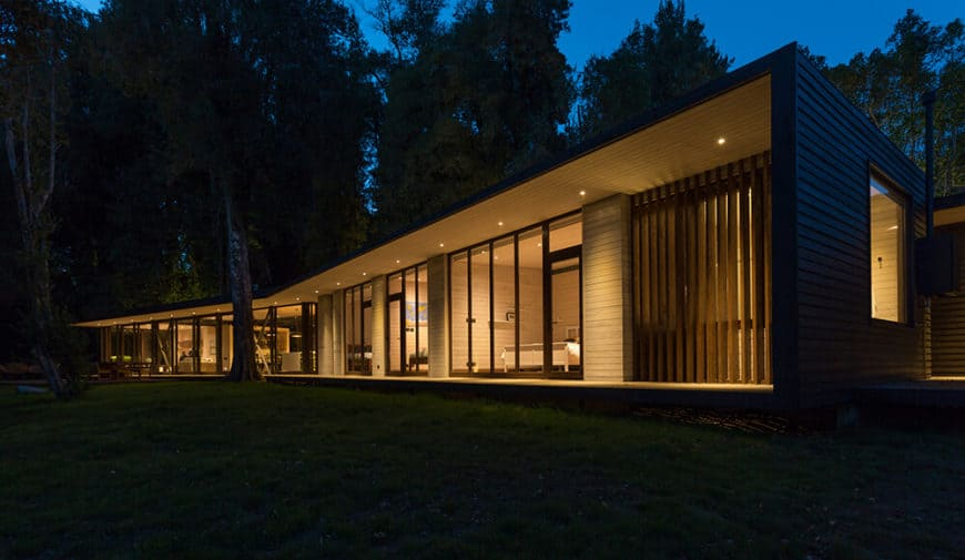 A modern black house in the middle of the woods. This home has a gorgeous interior.