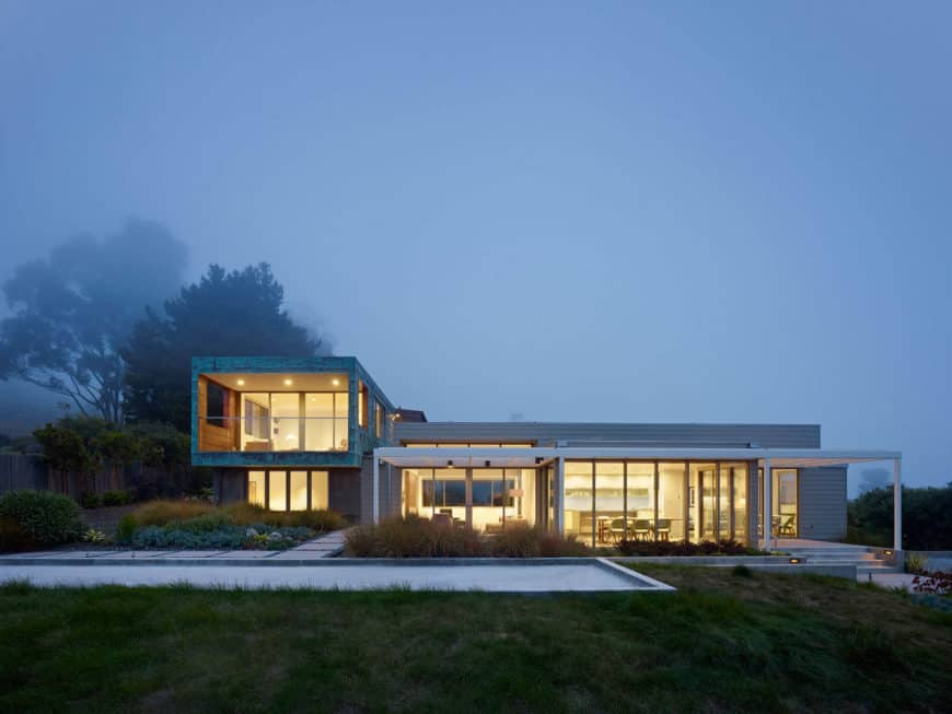 A large contemporary house with a nice driveway and a beautiful walkway.