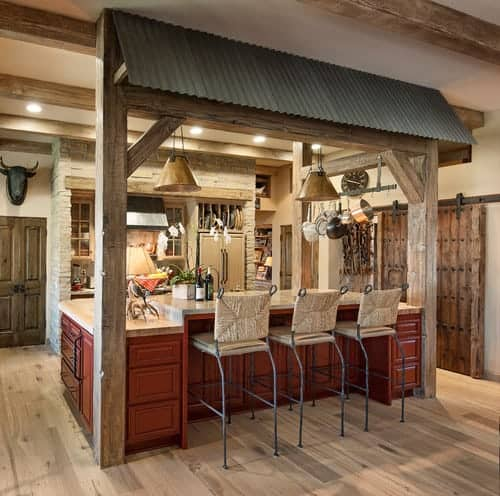 A very stylish kitchen with a custom island and breakfast bar counter, along with a ceiling with beams.