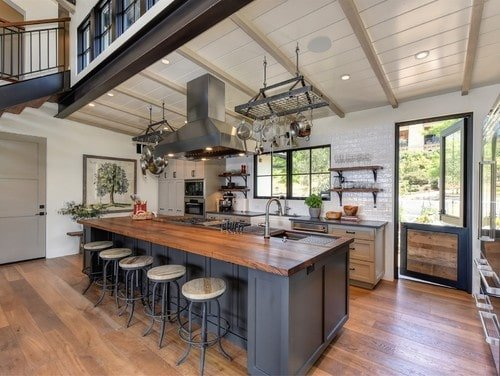 This kitchen offers a large island with a thick wooden countertop and space for a breakfast bar for five.