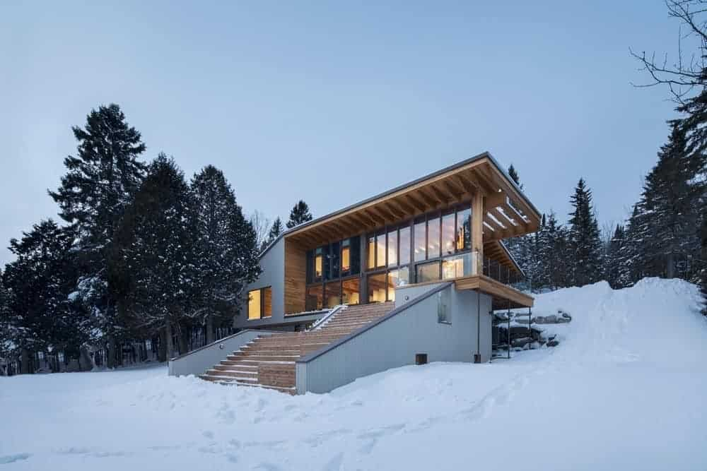 A contemporary house with a stylish exterior design and a gorgeous interior with warm lighting.