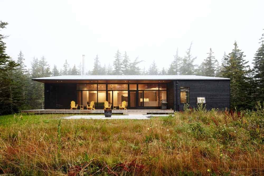 A large bungalow home with a black exterior and a modern interior.
