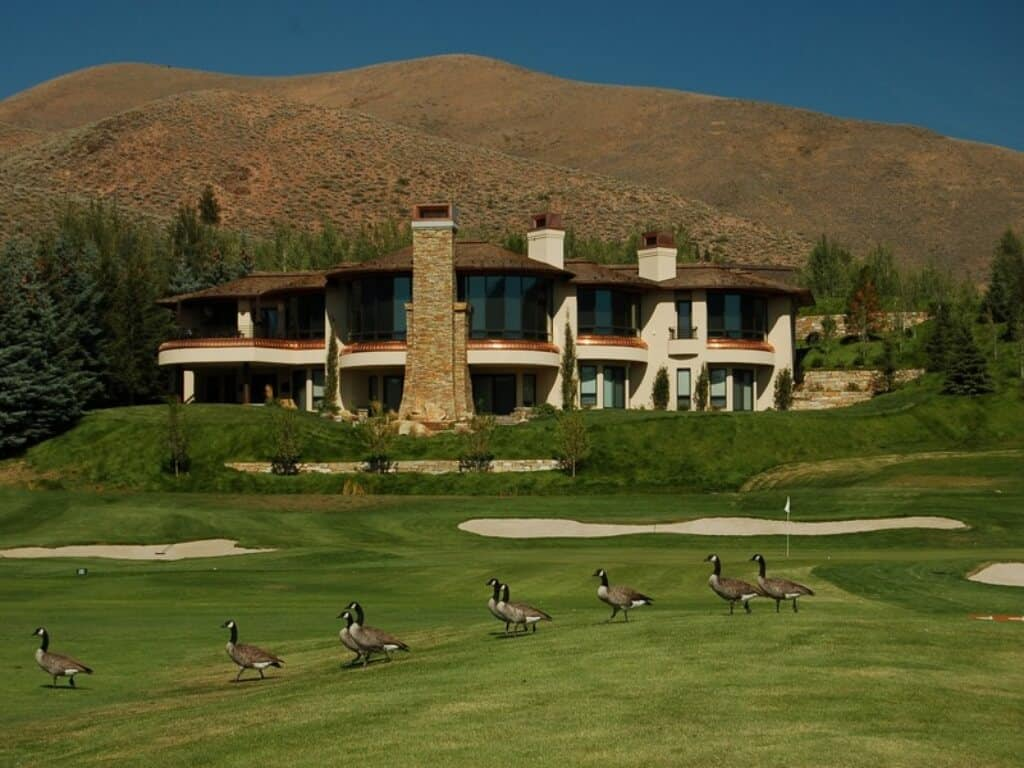 A contemporary mansion with a large golf course.