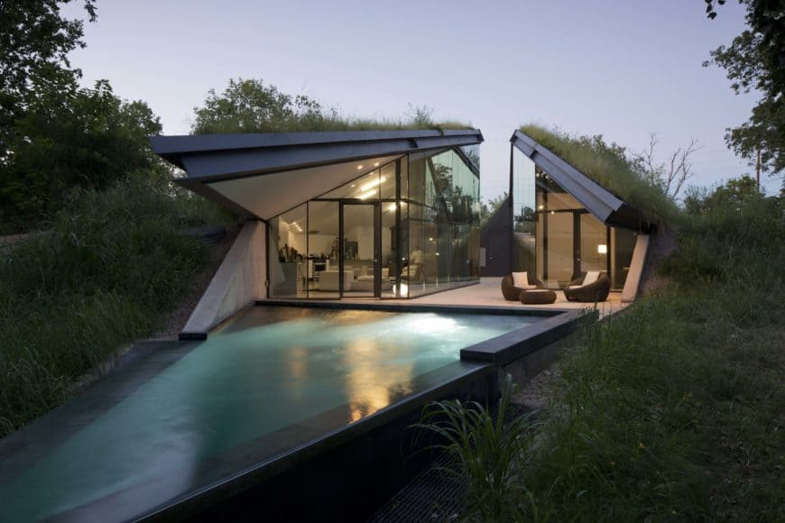 A contemporary home featuring a stylish architecture design with glass walls and windows.