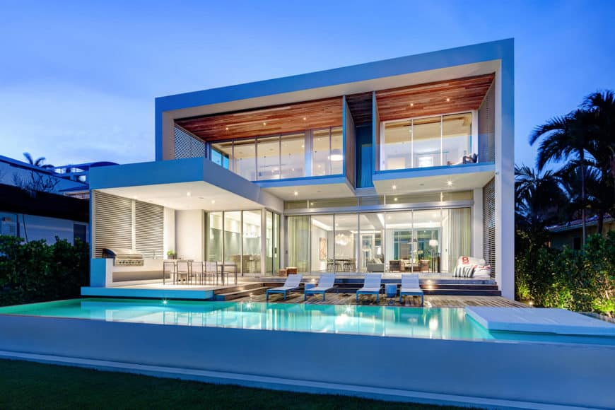 A contemporary house boasting very beautiful and entertaining outdoor areas with a swimming pool and an outdoor kitchen and dining.