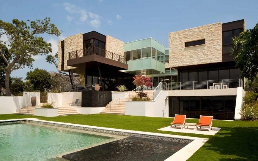 A contemporary residence in Florida featuring a nice outdoor area with well-maintained lawns and a swimming pool.