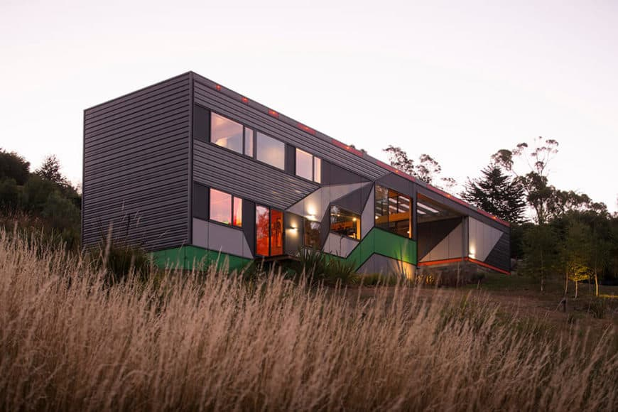 This black house features a stylish exterior design and a modish interior setup.