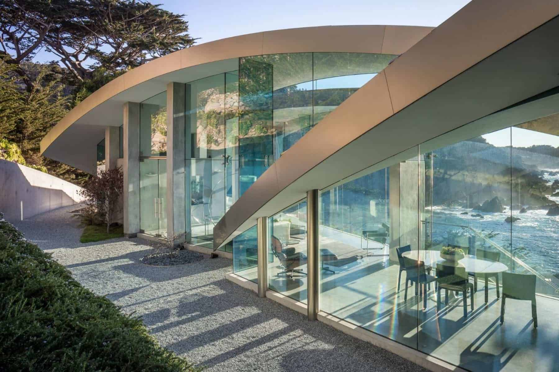 A spectacular curved-glass contemporary house that has an amazing exterior structure.