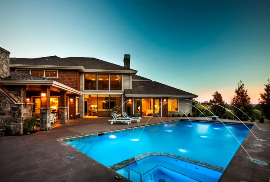 A beautiful contemporary home featuring a wonderful swimming pool in its outdoor area.