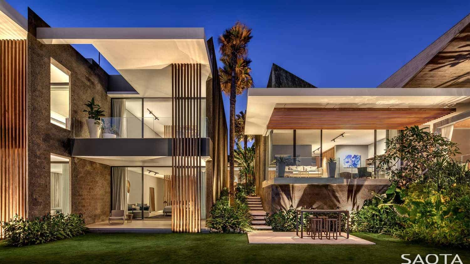 A huge contemporary house with a beautiful lawn and garden areas and has a nice interior as well.
