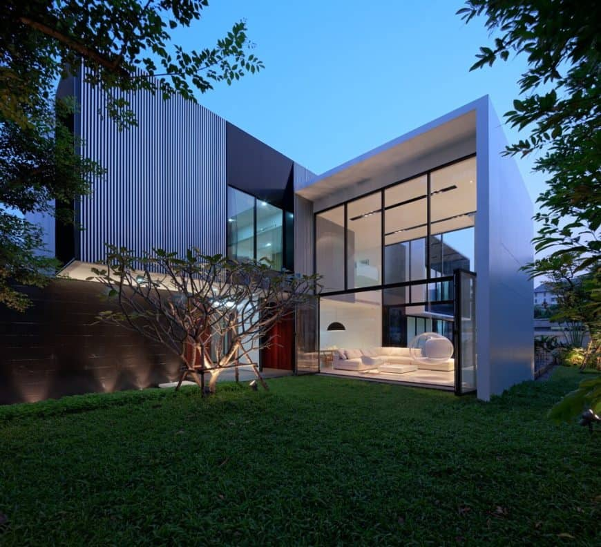 A contemporary house with healthy and well-maintained lawn area outside.