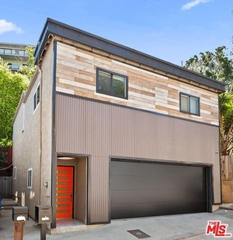 Industrial-style home with roll-up garage door window.