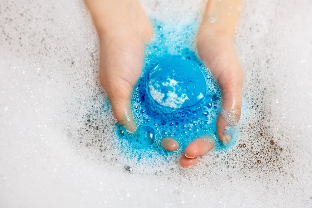 Blue colored bath bomb in the water