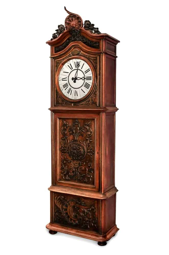 Brown clock against a white background
