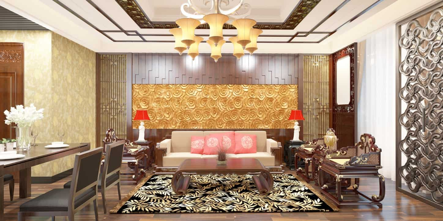 This luxurious living room is filled to the brim with patterns that dominate the wooden elements of the flooring, walls and sofa set. There are brilliant golden patterns on the wall that matches the modern chandelier over the black patterned area rug.