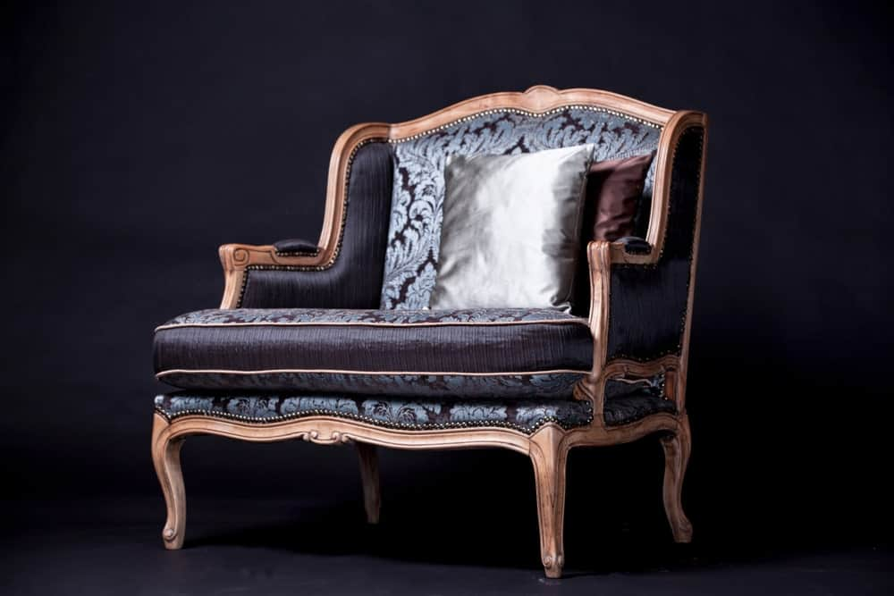 A black and silver printed silk upholstered bergere chair