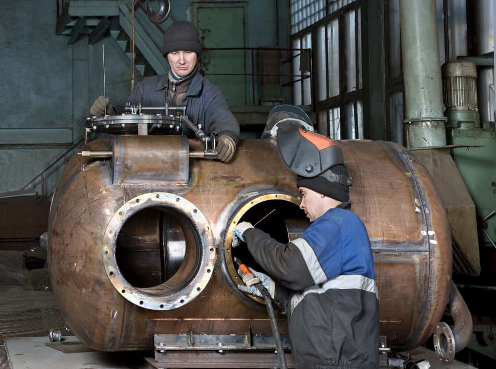 Boilermakers working on repairing some equipment