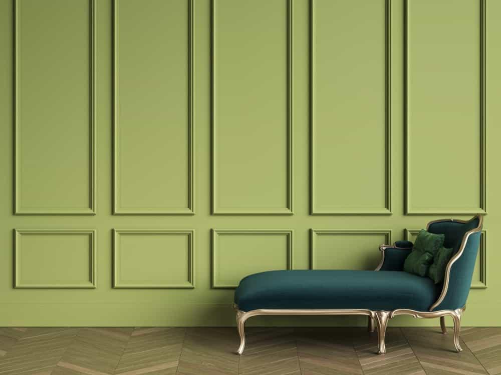 A green chaise longue