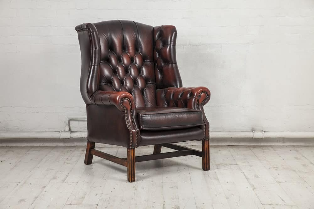 A deep burgundy Chesterfield chair