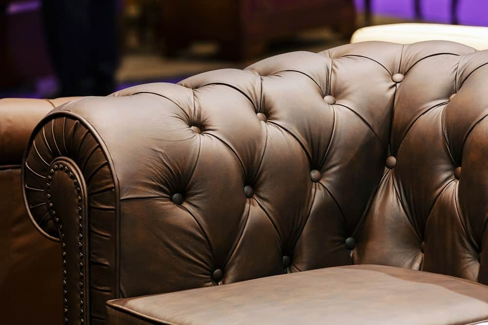Brown-colored leather sofa