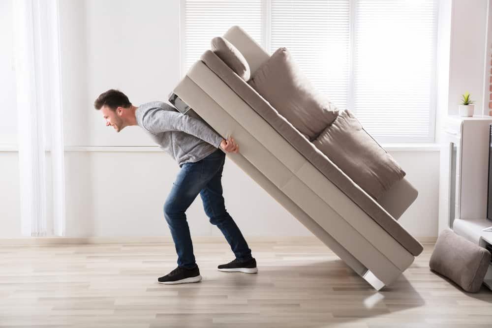 Man hauling sofa