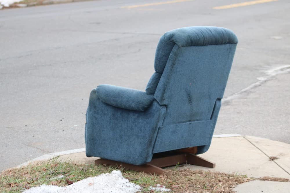 Old recliner chair on the street curb