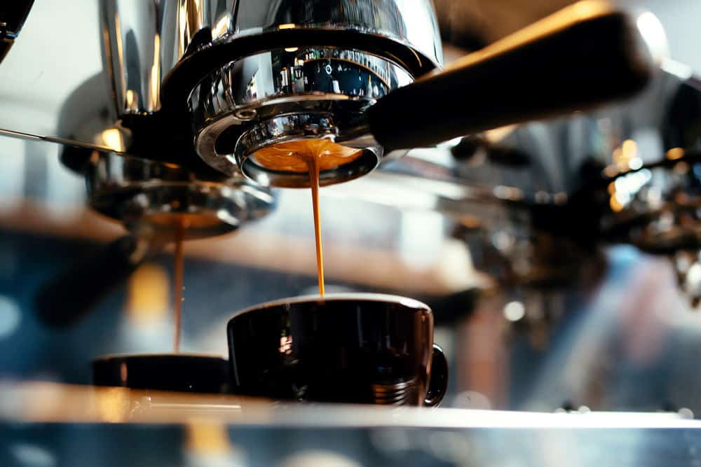 Photo of espresso maching pouring espresso
