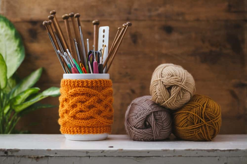 A jar with knitting needles and hooks