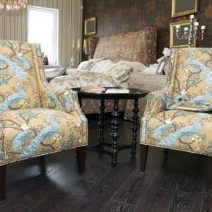 Twin upholstered chair printed with peacocks