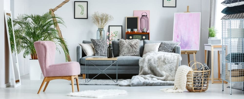 Upholstered gray-colored sofa in a stylish living room interior.