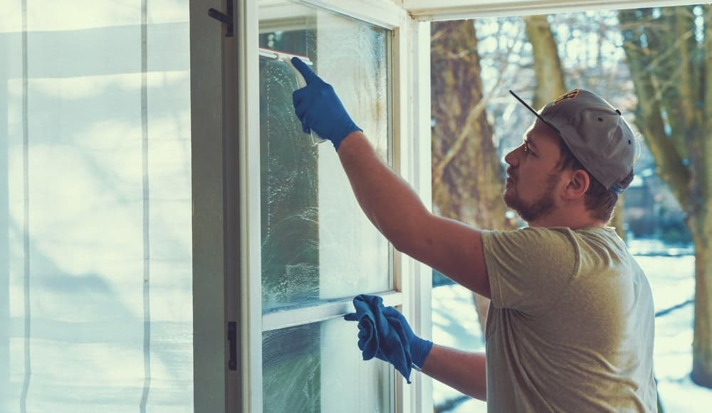 A professional cleaning windows