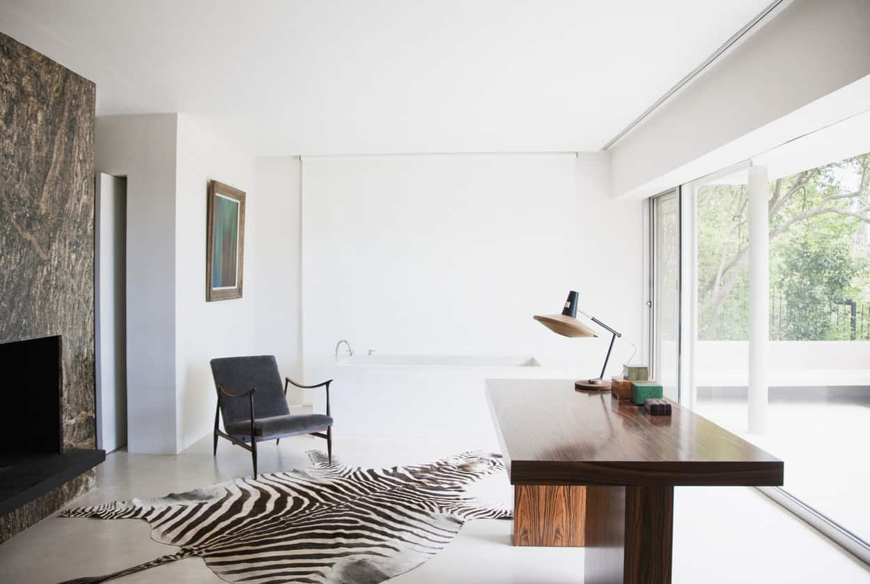 Home office with zebra print rug