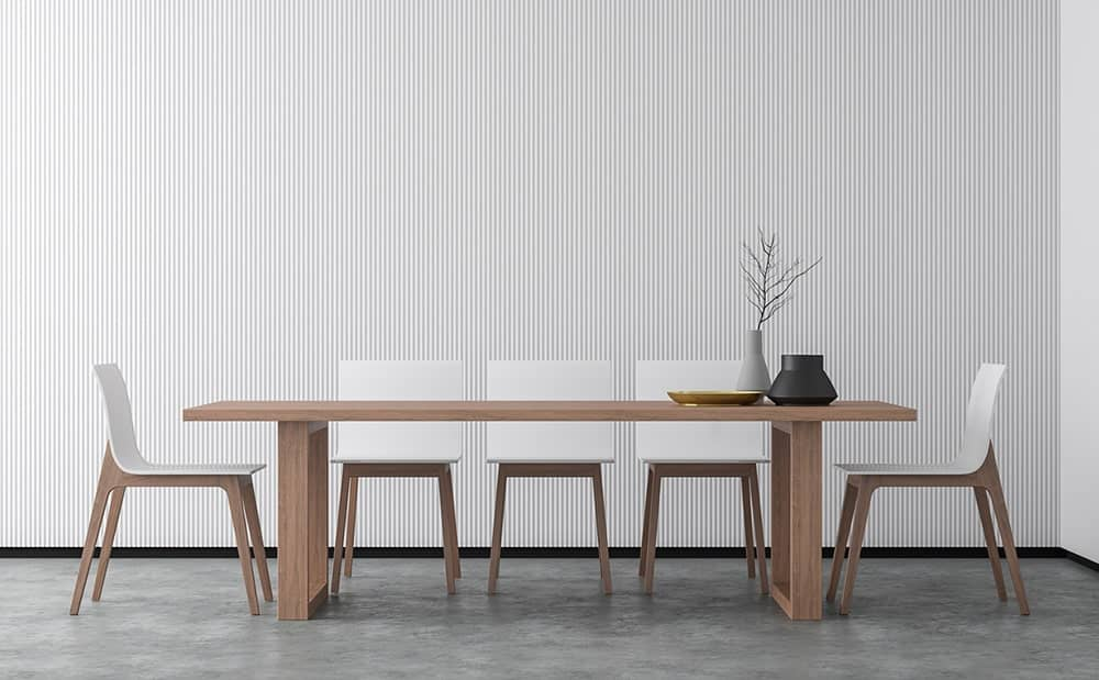 Asian dining room with a minimalist design showcasing sleek white chairs and natural wood dining table topped with black and gray vases.