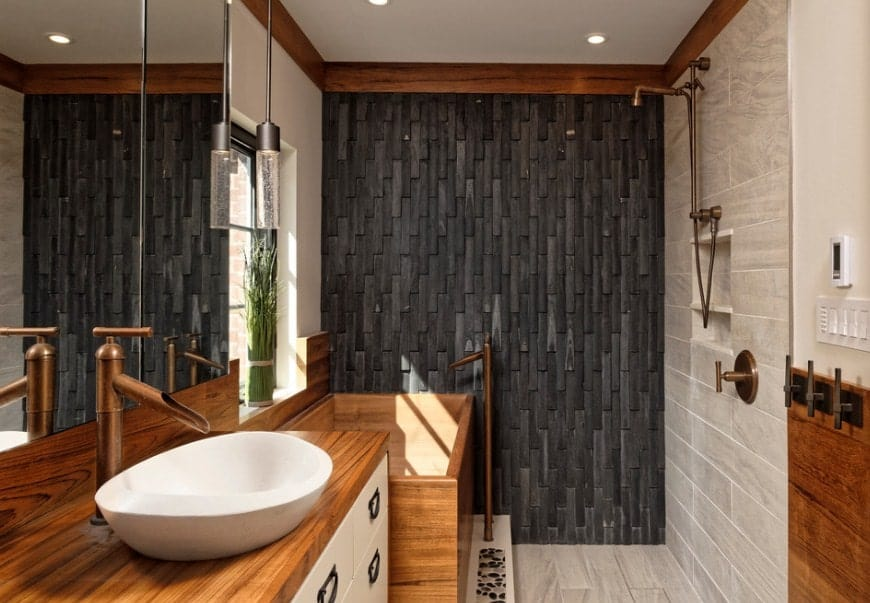 This Asian-style primary bathroom features a vessel sink, a wooden deep soaking tub and an open shower.
