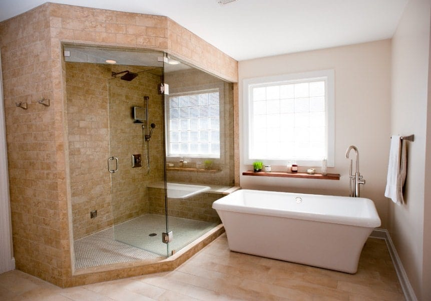 A focused shot at this Asian-style primary bathroom's corner walk-in shower and a freestanding tub.