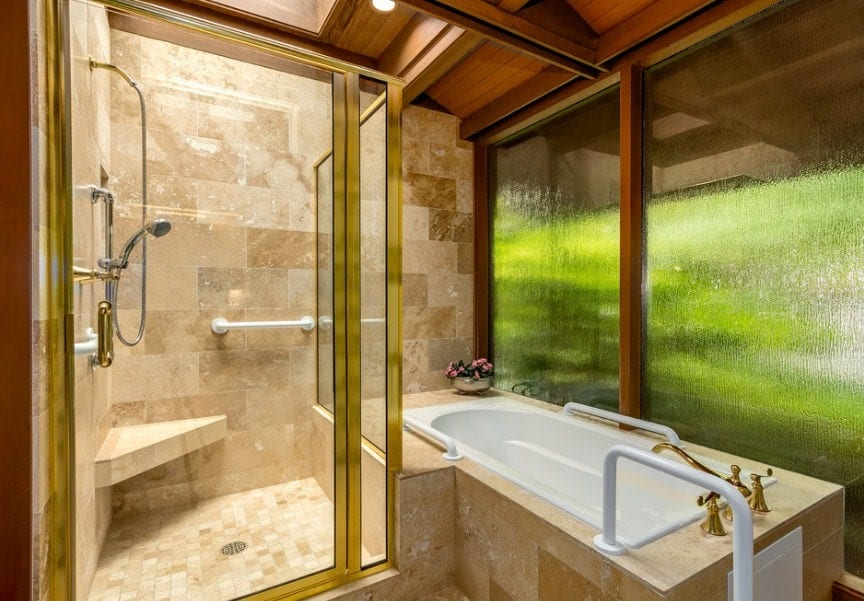 An Asian-style primary bathroom with a beautiful walk-in shower room along with a drop-in tub next to it.