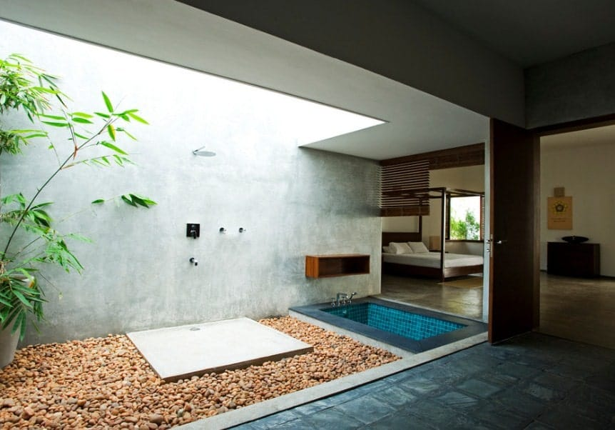 A primary suite featuring its own bathroom with an open shower and a deep soaking tub.