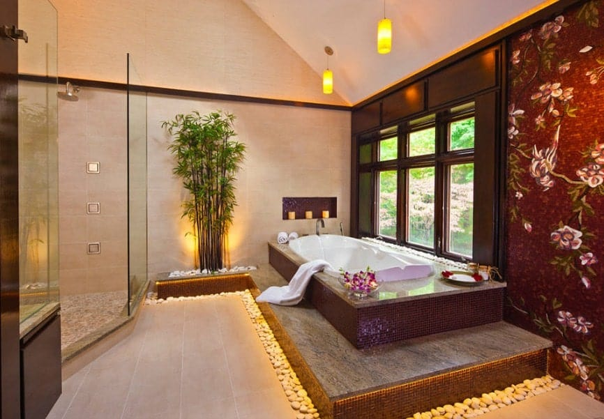 A beautiful Asian-style primary bathroom with a walk-in shower room, a drop-in tub with a nice platform and a decorated wall that looks so beautiful.