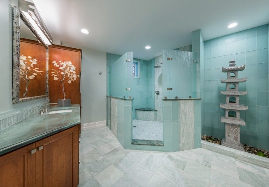 Green Asian-style primary bathroom featuring a single sink counter, a large walk-in shower and a very attractive stone decoration.