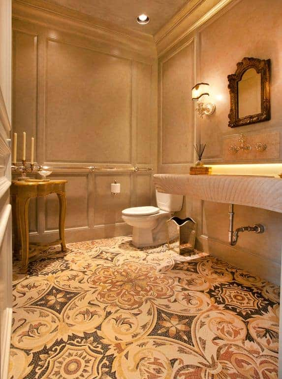 Warm bathroom with wainscoted walls and regular ceiling lined with crown molding. Decorative floor tiles add a stunning highlight to the room.