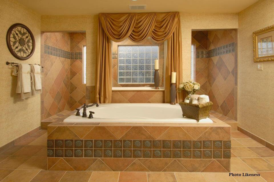 Classy bathroom offers a deep soaking tub accented with decorative tiles. It is designed with an ornate wall art and mirror mounted on the beige walls.